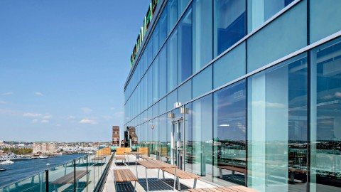 Modern Boston office spaces with window façade and terrace overlooking Boston waterfront